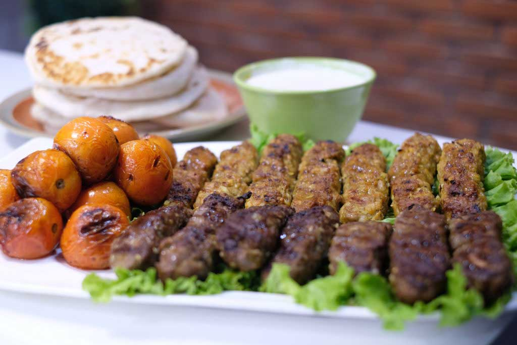 Grilled Chicken and Beef Kebabs with Homemade Pita Bread, Garlic-Yogurt Sauce and Grilled Tomatoes